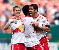Juan Pablo Angel (9) of the New York Red Bulls celebrates his goal with teammates Roy Miller (7) and Carl Robinson (33) at RFK Stadium in Washington, DC.  The New York Red Bulls defeated D.CC United, 2-0.
