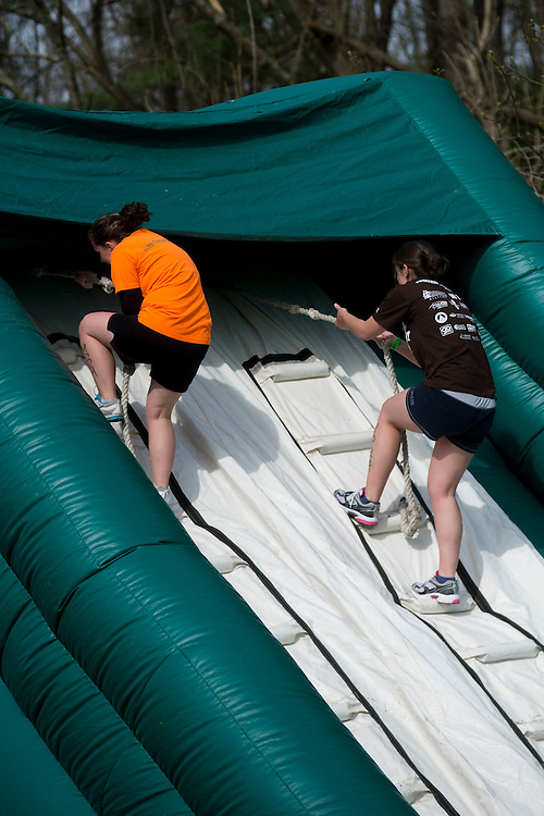 Participants of the O'bleness Health System Race for a Reason Mud Run go through the inflatable obstacle course before they make it up the hill to the old Army ROTC training course at the Ridges, Saturday, April 27, 2013. The Mud Run was a four-mile run up to the ROTC Course, through the Radar Hill Trail and back to Tail Great Park across from Peden Stadium. Race for a Reason, Race 4 A Reason, Annual Events, Events, Students, Faculty & Staff