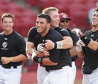Freshman infielder George Iskenderian (28) of the South Carolina Gamecocks, center, is mobbed by teammates after his two-out two-run walk-off homer in the bottom of the seventh inning to lift the Black team to a 3-2 win over the Garnet squad in Game 1 of the Garnet & Black World Series on Oct. 25, 2012, at Carolina Stadium in Columbia, South Carolina. These final weekend intrasquad games signal the end of fall practice. Game 2 is set for 6 p.m. Friday. (Tom Priddy/Four Seam Images)