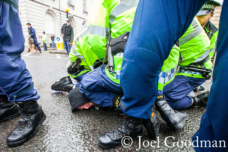© Joel Goodman - 07973 332324 . 09/06/2012. Rochdale , UK. A man is detained as EDL supporters are contain by police opposite Rochdale Town Hall . The English Defence League ( EDL ) hold a march and rally in Rochdale Town Centre . Photo credit : Joel Goodman