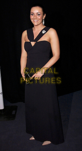 MARTINE McCUTCHEON.The British Independent Film Awards.Hammersmith Palais.London 30 November 2004..full length long black halterneck dress silver earrings brooch broach.Ref: FIN.www.capitalpictures.com.sales@capitalpictures.com.©Steve Finn/Capital Pictures .