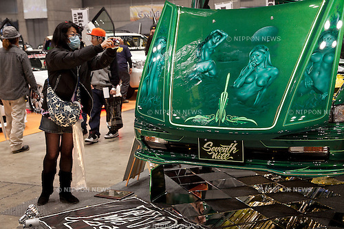 """April 21, 2013, Chiba, Japan - A visitor takes pictures of a custom car. The """"New Style Custom Autoshow NEXT 2013"""" for 5th time comes to Makuhari Messe to show luxury custom cars (Lamborghini, Maserati, Cadillac, Honda, Chevrolet, etc) which compete in 16 different """"New Style"""" categories. The exhibition brings beautiful Go-Go dancers who perform on the stage and pose for the cameras of visitors. The car show brings the ultimate of technology in illumination, audio and video system; car accessories, rims and new designs on chassis, everything to custom luxury cars. (Photo by Rodrigo Reyes Marin/AFLO).."""