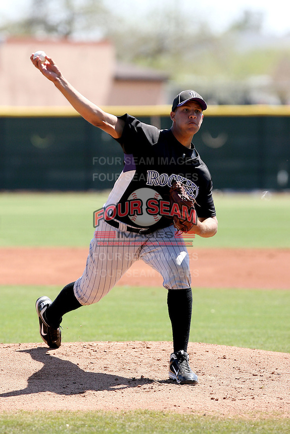 Albert Campos #76 of the Colorado Rockies plays in a minor league spring training game against the Los Angeles Angels at the Angels minor league complex on March 23, 2011  in Tempe, Arizona. .Photo by:  Bill Mitchell/Four Seam Images.