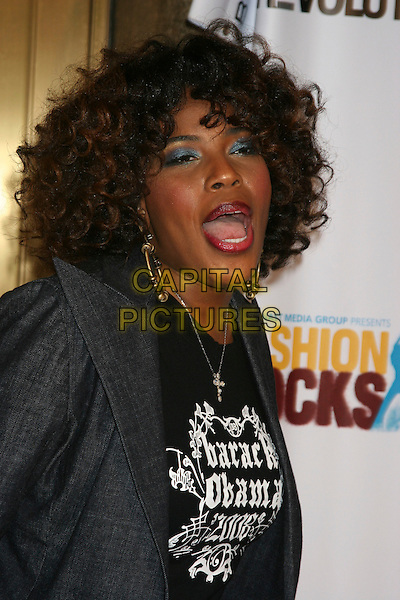 MACY GRAY.Arrivals at Fashion Rocks held at Radio City Music Hall,.New York, 8th September 2005.half length black t-shirt loop earrings mouth.Ref: IW.www.capitalpictures.com.sales@capitalpictures.com.©Capital Pictures