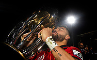 Richie Mo'unga of the Crusaders celebrates with the trophy following the 2018 Super Rugby final between the Crusaders and Lions at AMI Stadium in Christchurch, New Zealand on Sunday, 29 July 2018. Photo: Joe Johnson / lintottphoto.co.nz