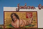 Fat woman in string bikini bill board at Jawbone Canyon, Calif.