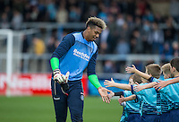 Goalkeeper Jamal Blackman of Wycombe Wanderers with matchday mascots during the Sky Bet League 2 match between Wycombe Wanderers and Barnet at Adams Park, High Wycombe, England on 22 October 2016. Photo by Kevin Prescod.