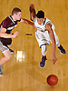 Jared Rhoden #32 of Baldwin, right, gets pressured by Josh Pismeny #1 of Deer Park during the penultimate game in the Tip of the Hat Classic at Adelphi University on Sunday, Jan. 10, 2016.