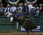 TylerSmith from Fruita, CO falls while competing in the Bull Riding event during Wolf Pack Night at the Reno Rodeo on Wednesday, June 22, 2016.