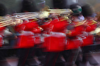 Guards band during the handover of Changing the Guard (or Guard Mounting), Buckingham Palace, London, UK. The picture captures the rythm of the soldiers on the march and the brightness of the brass instruments. Picture by Manuel Cohen
