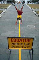 Boy straddling the equator, Quatorial Monument, Quito, Ecuador
