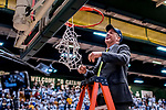 16 March 2019: University of Vermont Catamount Head Coach John Becker cuts the remaining piece of net after a victory against the UMBC Retrievers in the America East Championship Game at Patrick Gymnasium in Burlington, Vermont. The Catamounts defeated the Retrievers 66-49, avenging their loss against the same team in last years' Championship Game. Mandatory Credit: Ed Wolfstein Photo *** RAW (NEF) Image File Available ***