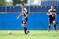 10 September 2011:  FIU's Roberto De Sousa (20) moves the ball upfield in the first half as the FIU Golden Panthers defeated the Stetson University Hatters, 3-2 in the second overtime period, at University Park Stadium in Miami, Florida.