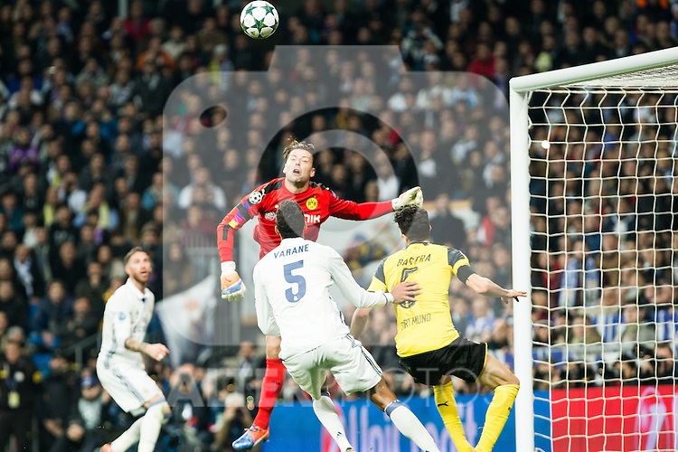Real Madrid's Raphael Varane, Borussia Dortmund Roman Weidenfeller, Marc Bartra during Champions League match between Real Madrid and Borussia Dortmund  at Santiago Bernabeu Stadium in Madrid , Spain. December 07, 2016. (ALTERPHOTOS/Rodrigo Jimenez)