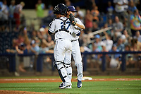 Charlotte Stone Crabs relief pitcher Chandler Raiden (25) and catcher Ronaldo Hernandez (27) after closing out a Florida State League game against the Fort Myers Miracle on April 6, 2019 at Charlotte Sports Park in Port Charlotte, Florida.  Fort Myers defeated Charlotte 7-4.  (Mike Janes/Four Seam Images)