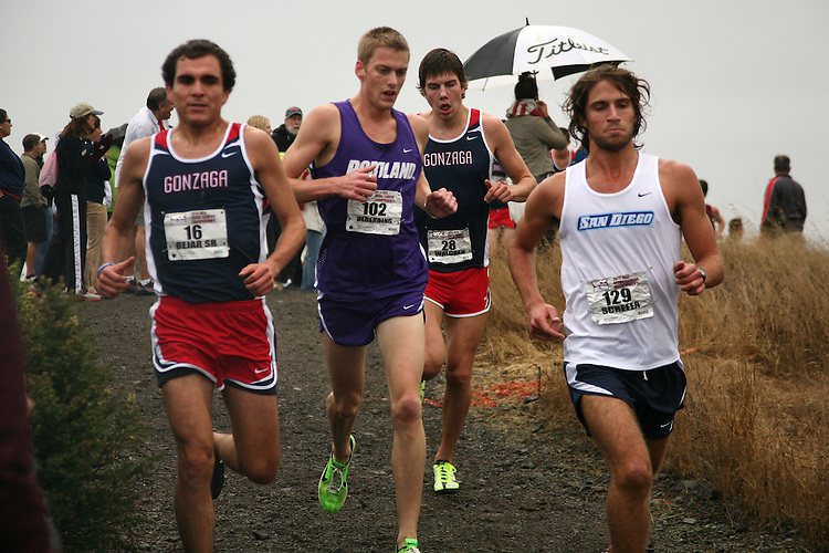 October 30, 2010; Belmont, CA, USA; Gonzaga Bulldogs runner Matthew Bejar (16), Portland Pilots runner Scott Olberding (102), Gonzaga Bulldogs runner Robert Walgren (28), and San Diego Toreros runner Willie Schefer (129) compete during the WCC Cross Country Championships at Crystal Springs in Belmont, California.