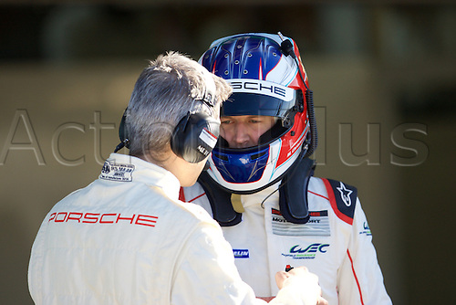 28.03.2015.  Le Castellet, France. World Endurance Championship Prologue Day 2. Porsche Team Manthey driver Michael Christensen talks to his engineer.