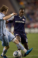 New England Revolution midfielder Joseph Niouky (23) dribbles as Colorado Rapids defender Danny Earls (2) defends. The Colorado Rapids defeated the New England Revolution, 2-1, at Gillette Stadium on April 24, 2010.