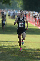 NWA Democrat-Gazette/ANDY SHUPE<br /> Bentonville's Lukas Pabst comes in to the finish Saturday, Oct. 5, 2019, to take third place in the boys El Caliente during the Chile Pepper Cross Country Festival at Agri Park in Fayetteville. Visit nwadg.com/photos to see more photographs from the races.