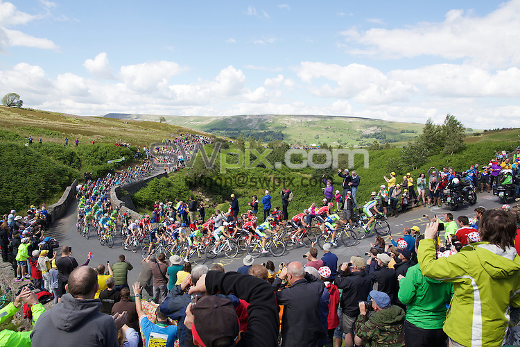 Picture by Shaun Flannery/SWpix.com - 05/07/2014 - Cycling - Tour de France 2014 Grand Depart - Stage 1, Leeds to Harrogate - Yorkshire, England - <br /> Grinton Moor, Yokshire Dales.<br /> The Peloton makes it's way up Grinton Moor on day 1 of Le Tour