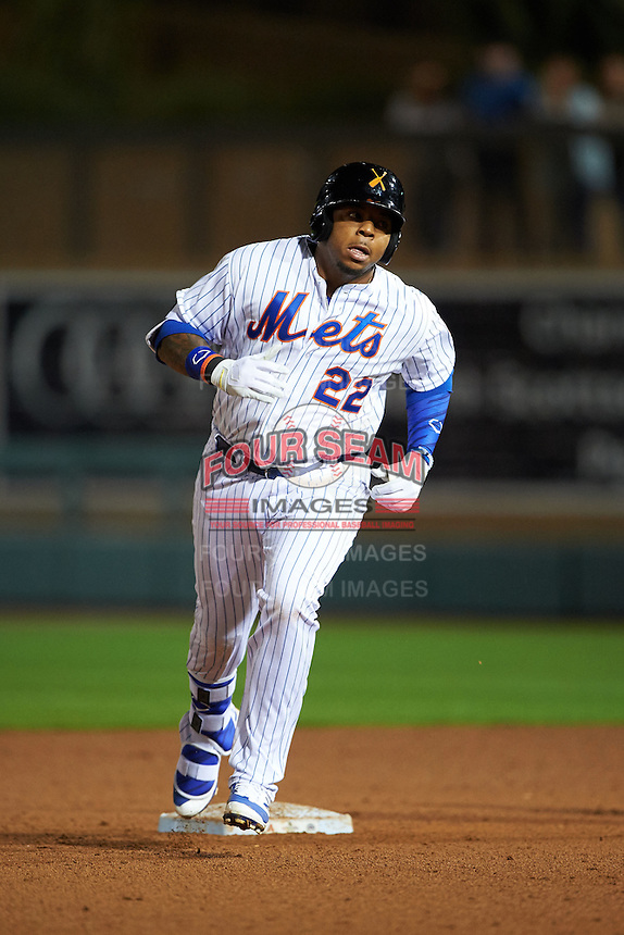 Salt River Rafters first baseman Dominic Smith (22) runs the bases after hitting a home run during an Arizona Fall League game against the Glendale Desert Dogs on October 22, 2015 at Salt River Fields at Talking Stick in Scottsdale, Arizona.  Glendale defeated Salt River 7-5.  (Mike Janes/Four Seam Images)