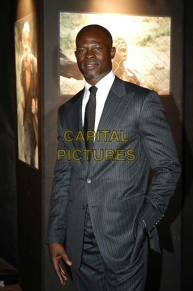 "DJIMON HOUNSOU.""Blood Diamond"" photocall at Cinema Warner Moderno, Rome, Italy..half length  grey gray pinstripe suit jacket .January 24th, 2007.CAP/CAV.©Luca Cavallari/Capital Pictures"