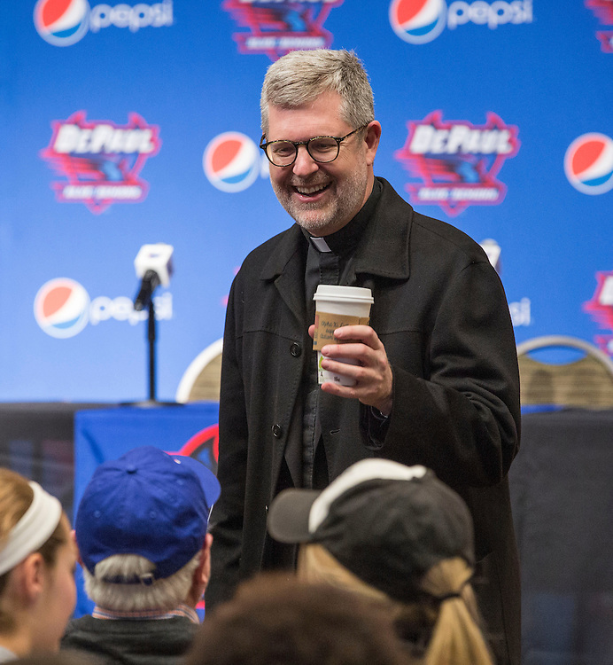 The Rev. Dennis H. Holtschneider, C.M., president of DePaul University, greets attendees at a press conference Monday, March 30, 2015, where Dave Leitao was introduced as the new head coach of the men's basketball program. (DePaul University/Jamie Moncrief)