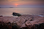 Sunrise on the rocky coast of Downeast Maine, seen from the Ocean Path in Acadia National Park, ME, USA