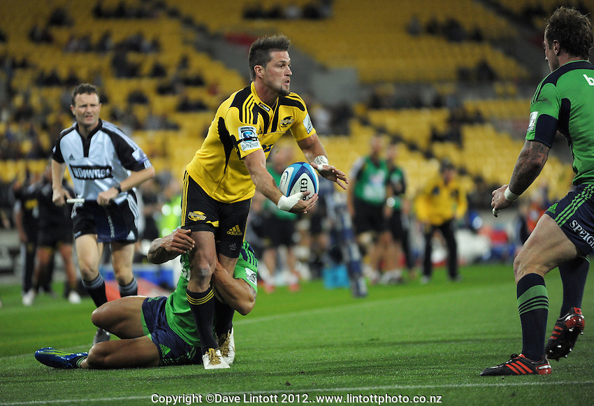 Cory Jane dummies on his way to scoring during the Super 15 rugby match between the Hurricanes and Highlanders at Westpac Stadium, Wellington, New Zealand on Saturday, 17 March 2012. Photo: Dave Lintott / lintottphoto.co.nz