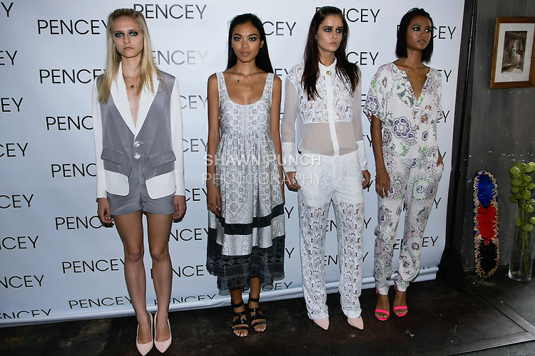Models pose in outfits from the Pencey Spring Summer 2013 collection, during New York Fashion Week, September 6, 2012