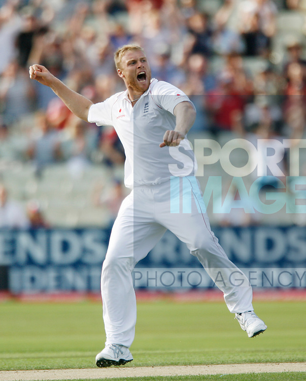 England's Andrew Flintoff celebrates taking the wicket of South Africa's Graeme Smith for 7
