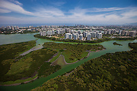 Lagoa de Jacarepagua at Barra da Tijuca neighborhood in the west zone of Rio de Janeiro, Brazil - unfit for swimming, fishing and water sports due to pollution - luxury condominiums with americanized lifestyle in background.  The real estate 'boom' in Rio right after the city was chosen for the 2016 Summer Olympic Games affected the prices in Barra that will host most of the venues of the Games.