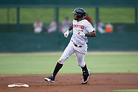 Micker Adolfo (27) of the Kannapolis Intimidators watches the ball in the outfield as he approaches second base during the game against the Hagerstown Suns at Kannapolis Intimidators Stadium on June 14, 2017 in Kannapolis, North Carolina.  The Intimidators defeated the Suns 10-1 in game two of a double-header.  (Brian Westerholt/Four Seam Images)