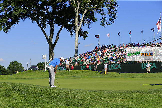Dustin Johnson (USA) takes his putt on the 18th green during Friday's Round 2 of the 2016 U.S. Open Championship held at Oakmont Country Club, Oakmont, Pittsburgh, Pennsylvania, United States of America. 17th June 2016.<br /> Picture: Eoin Clarke | Golffile<br /> <br /> <br /> All photos usage must carry mandatory copyright credit (&copy; Golffile | Eoin Clarke)