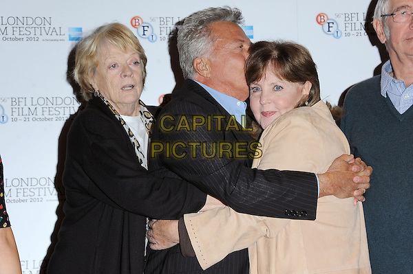 Maggie Smith, Dustin Hoffman and Pauline Collins.photocall for 'Quartet' ahead of the Gala Screening during the 56th BFI London Film Festival, Empire Leicester square, London, England..15th October 2012.half length black beige blue hug embrace funny kiss kissing profile side suit.CAP/BEL.©Tom Belcher/Capital Pictures.