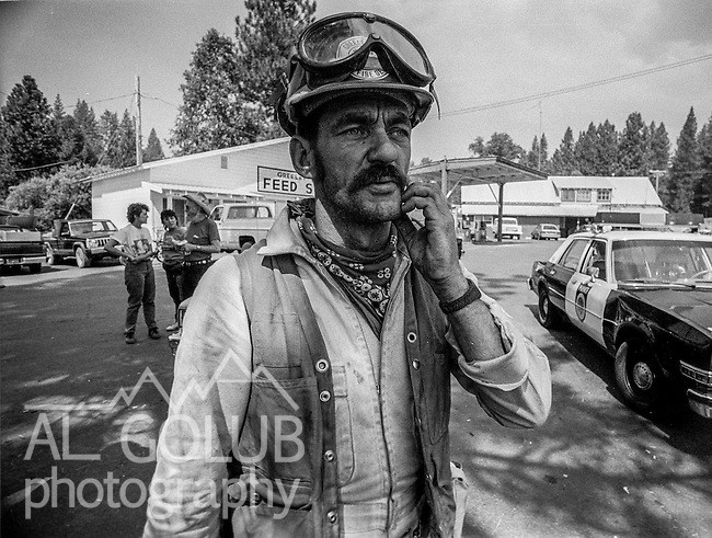 September 4, 1987 Greeley Hill, California – Stanislaus Complex Fire -- Volunteer firefighter Danny Watkins checks in before heading to his assignment.  The Stanislaus Complex Fire consumed 28 structures and 145,980 acres.  One US Forest Service firefighter, David Ross Erickson, died from a tree-felling accident.