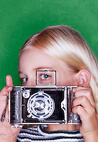 Female student with old camera.