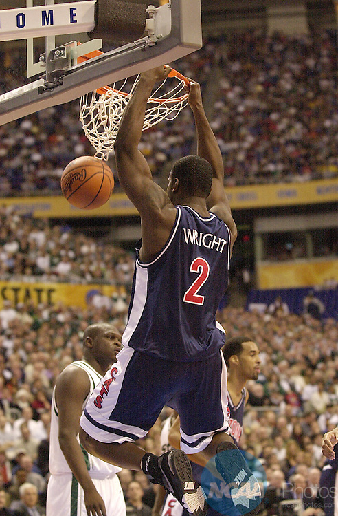 31 MAR 2001:  University of Arizona forward Michael Wright (2) slam dunks the ball in front of Michigan State defender during the Division 1 semifinal game of the Men's Final Four Basketball Championship held at the Hubert H. Humphrey Metrodome in Minneapolis, MN. Arizona defeated Michigan St. 80-61 to advance to the Championship game. Ryan McKee/NCAA Photos.DIGITAL IMAGE ONLY