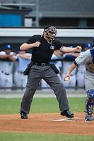 Home plate umpire Grant Hinson calls a batter out on strikes during the Appalachian League game between the Bluefield Blue Jays and the Burlington Royals at Burlington Athletic Stadium on June 27, 2016 in Burlington, North Carolina.  The Royals defeated the Blue Jays 9-4.  (Brian Westerholt/Four Seam Images)
