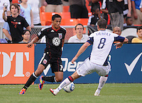 DC United midfielder Andy Najar (14) goes against New England Revolution defender Chris Tierney (8)  New England Revolution defeated DC United 1-0,at RFK Stadium, Wednesday July 20, 2011.