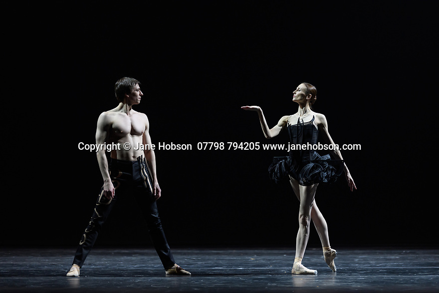 "London, UK. 02.12.19. Svetlana Zakharova, the Bolshoi's Prima and the first and only Russian Etpile at Teatro alla Scala, returns to the London Coliseum, with MODANSE, a new double bill produced by Muzarts. Zakharova is joined on stage by a cast of dancers from the Bolshoi Ballet, including Mikhail Lobukhin, Vaycheslav Lopatin, Denis Savin, Jacopo Tissi and Ana Turazashvili. The piece shown is: 'Come un Respiro"" (Like a Breath), choreographed by Mauro Bigonzetti, in its UK premiere. The dancers are: Svetlana Zakharova, Denis Savin, Jacopo Tissi, Mikhail Lobukhin, Vyacheslav Lopatin, Ana Turazashvili, Anastasia Stashkevich, Victoria Litvinova, Marfa Fyodorova, Tatiana Osipova, Anita Pudikova, Anna Zakaraya, Karim Abdullin, Alexei Gaynutdinov, Anton Gaynutdinov. Picture shows: Svetlana Zakharova, Denis Savin. Photograph © Jane Hobson."