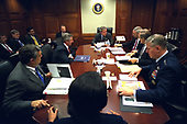 On Friday morning, March 21, 2003, United States President George W. Bush meets with his war council in the Situation Room of the White House. Present at the table are from foreground, National Security Advisor Condoleezza Rice, CIA Director George Tenet, Chief of Staff Andy Card, Secretary of State Colin Powell, Secretary of Defense Donald Rumsfeld and Chairman of the Joint Chiefs of Staff Richard B. Myers.<br /> Mandatory Credit: Eric Draper / White House via CNP
