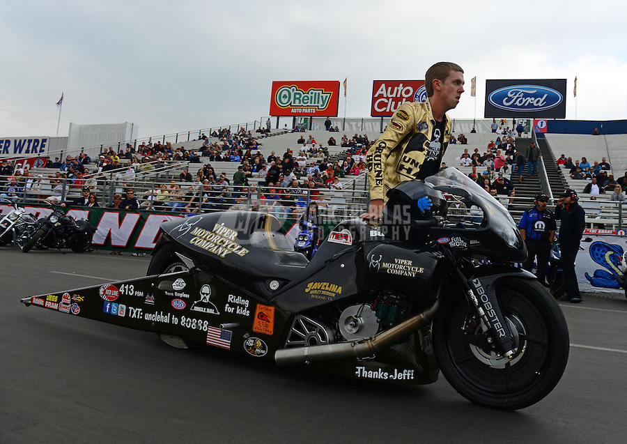 Nov. 8, 2012; Pomona, CA, USA: NHRA pro stock motorcycle rider Michael Ray during qualifying for the Auto Club Finals at at Auto Club Raceway at Pomona. Mandatory Credit: Mark J. Rebilas-