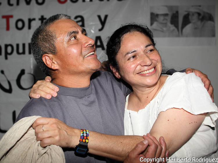 Gloria Arenas Agis and her husband Jacobo Silva Nogales hug each other during a press conference after being freed from prison , October 30, 2009. Silva Nogales and his wife Gloria Arenas were detained by the Mexican army and accused of rebellion as guerrilla chiefs of the Revolutionary Army of the Insurgent people (ERPI) on October 19 and 22 of 1999, and imprisoned in a high security prison for more than ten years as political prisoners by the Mexican government. Photo by Heriberto Rodriguez