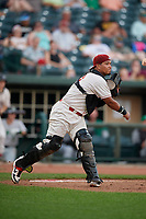 Great Lakes Loons catcher Jair Camargo (21) throws to first to complete the strikeout during a Midwest League game against the Clinton LumberKings on July 19, 2019 at Dow Diamond in Midland, Michigan.  Clinton defeated Great Lakes 3-2.  (Mike Janes/Four Seam Images)