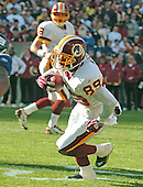 Landover, MD - December 24, 2005 --  Washington Redskin wide receiver Santana Moss (89) eludes a tackler en route to a first quarter touchdown against the New York Giants at FedEx Field in Landover, MD on December 24, 2005.  The Redskins won the game 35 - 20..Credit: Ron Sachs / CNP.(RESTRICTION: NO New York or New Jersey Newspapers or newspapers within a 75 mile radius of New York City)