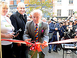 Fergal Quinn cuts the ribbon to officially open of the Local Heroes office on West street. Photo: Colin Bell/pressphotos.ie
