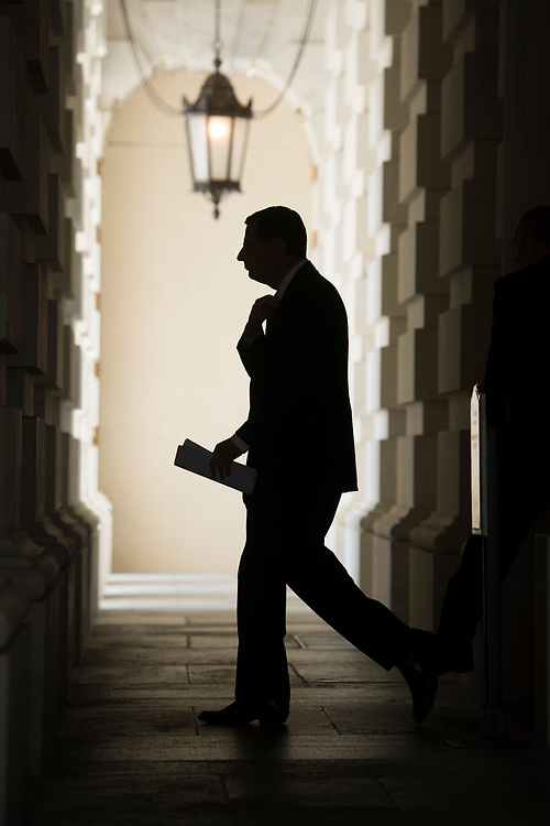 UNITED STATES - JULY 19: Sen. John Barrasso, R-Wyo., leaves the Capitol before boarding a bus to bring Republican senators to lunch at the White House with President Trump to discuss the health care plan on July 19, 2017. (Photo By Tom Williams/CQ Roll Call)