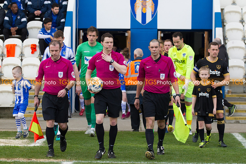 The officials lead the teams out during Colchester United vs Portsmouth, Sky Bet EFL League 2 Football at the Weston Homes Community Stadium on 11th March 2017