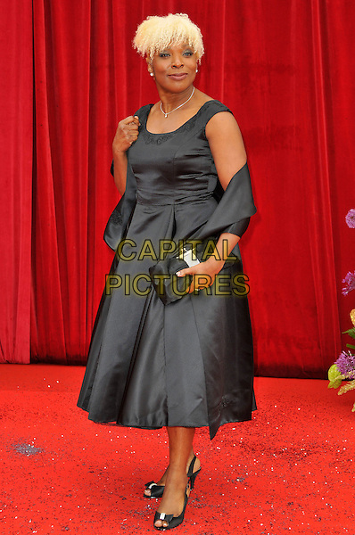 LORNA LAIDLAW .Attending the British Soap Awards 2011, .Granada Television Studios, Quay Street, Manchester, England, UK, .March 14th 2011..arrivals full length black dress  wrap sleeveless clutch bag .CAP/CAS.©Bob Cass/Capital Pictures.
